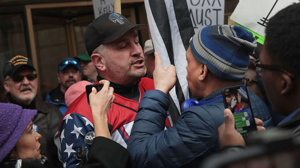Opposing sides argue during a demonstration organized by the Fraternal Order of Police to call for Foxx's removal, April 01, 2019, in Chicago.