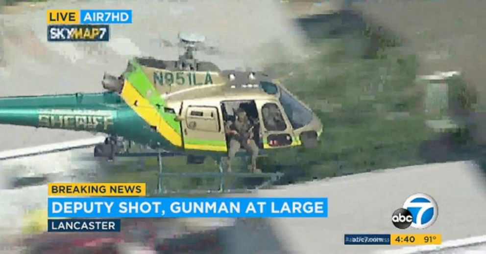 PHOTO: This Aug. 21, 2019 file image taken from KABC-TV video shows a sheriffs department helicopter with a sniper in an open door searching for a gunman at large in Lancaster, Calif.
