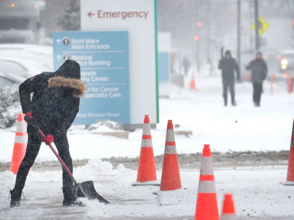 PHOTO: A worker shovels snow from a sidewalk, Nov. 11, 2019, in Chicago.