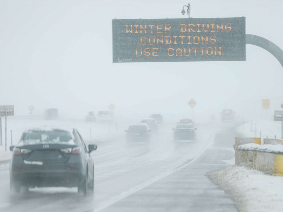 PHOTO: Drivers make their way along slick and snowy roads, Nov. 26, 2019, in Denver.
