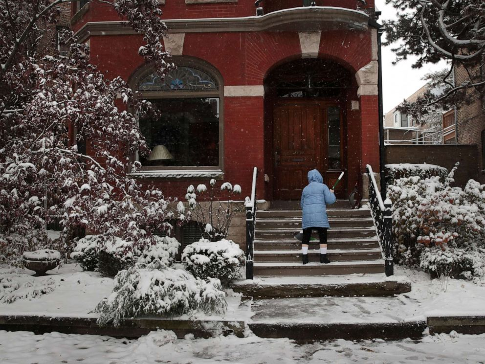 PHOTO:A resident clears snow from her steps in the Wicker Park neighborhood, Nov. 11, 2019 in Chicago.