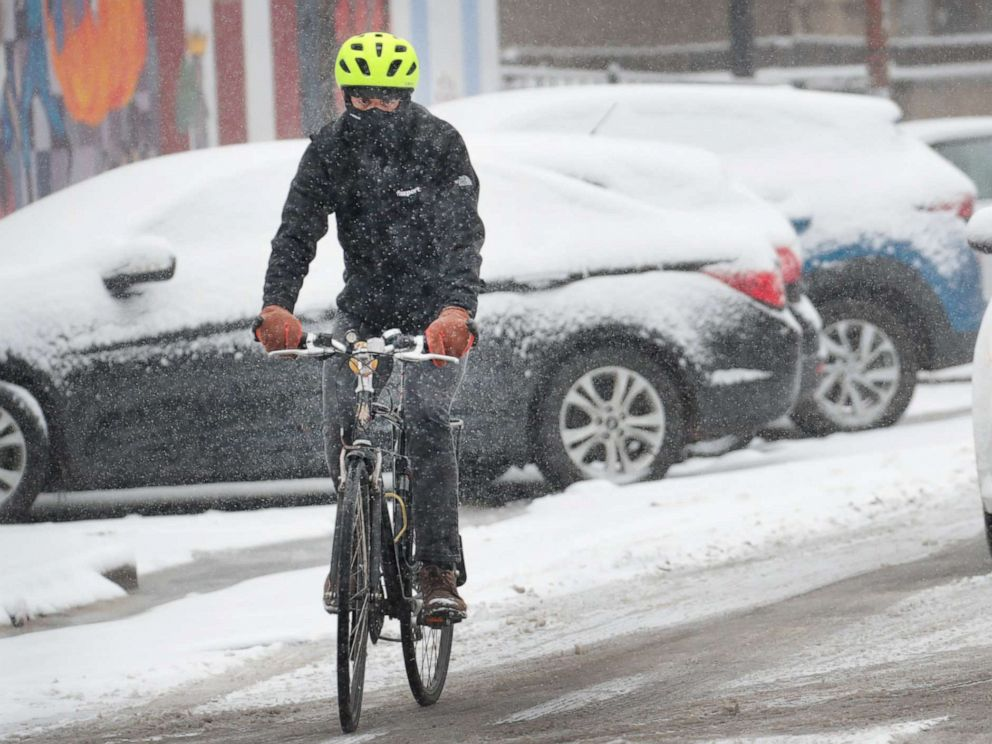 PHOTO: A cyclist navigates a snow-covered street in the Humboldt Park neighborhood, Nov. 11, 2019, in Chicago.