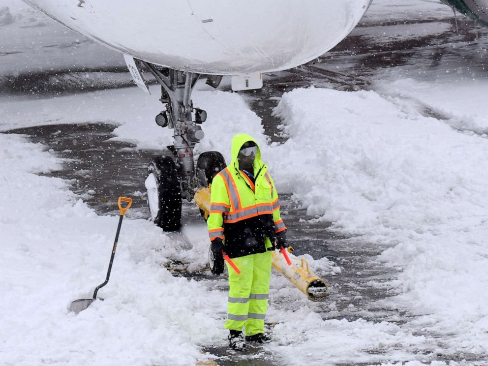 PHOTO:Ground crews remove snow from the airport tarmac as flights resume after an overnight snowfall, at the Albany International Airport in Colonie, N.Y., Dec. 2, 2019.
