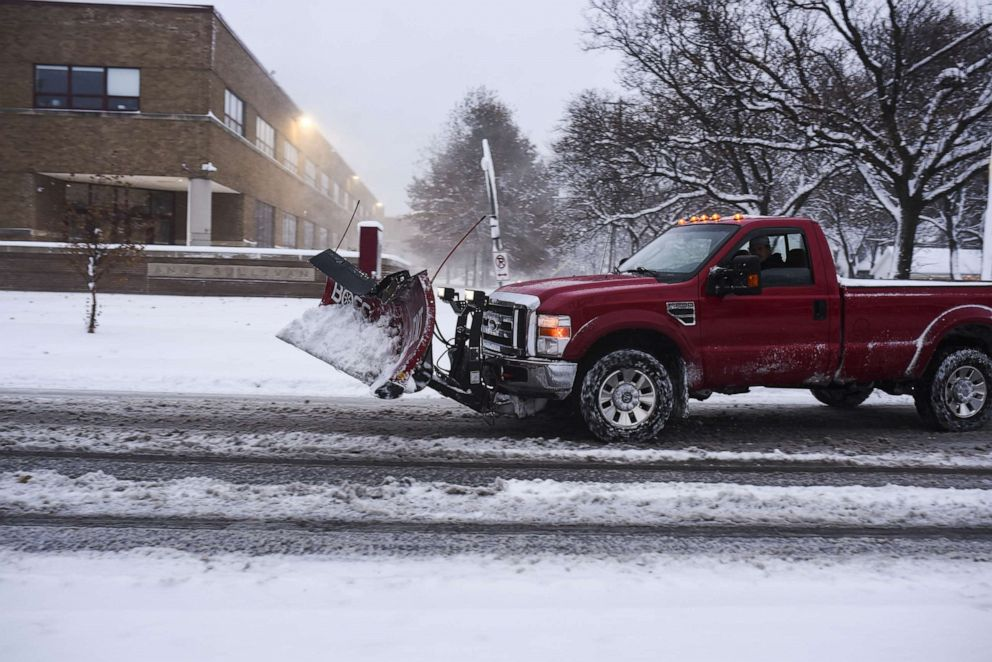 PHOTO: A snowplow truck drives by after a blizzard struck overnight, Nov. 27, 2019, in Minneapolis.