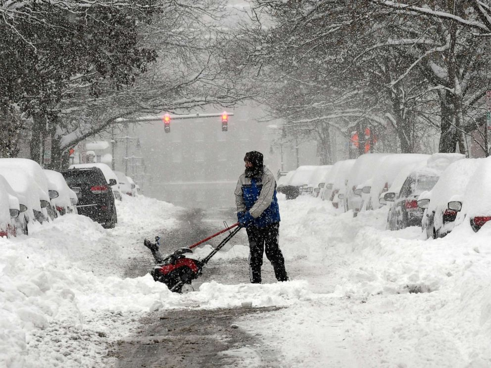 PHOTO: Mike Coutsonikas, spends the day earning extra money helping people dig out their cars and clear sidewalks on State street after an overnight snowfall, in Albany, N.Y., Dec. 2, 2019.