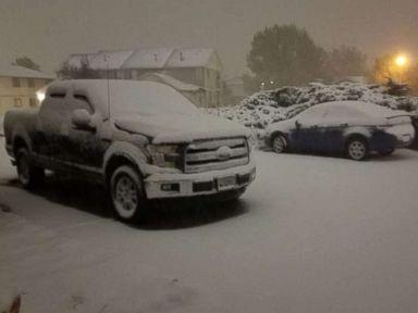 Snow blanketing Colorado while rain moves into central Texas