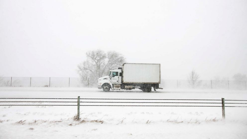 A truck drives north on I-25 during the snowstorm in Colorado Springs, Colo., March 13, 2019.