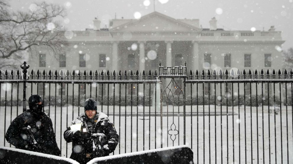 U.S. Secret Service Uniform Division officers stand watch as heavy snow falls at the White House, Feb. 20, 2019, in Washington, D.C.