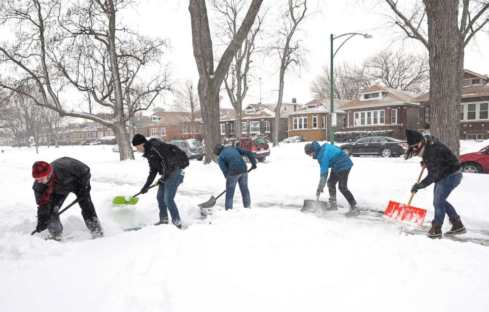PHOTO: Volunteers shovel sidewalks on South Wabash Avenue in the Chatham neighborhood in Chicago, Jan. 19, 2019.