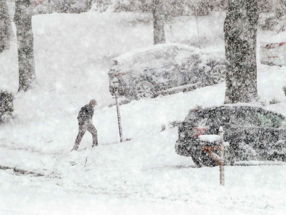 PHOTO: A man walks back from his mail box during a winter storm, March 7, 2018, in Springfield, Pa.
