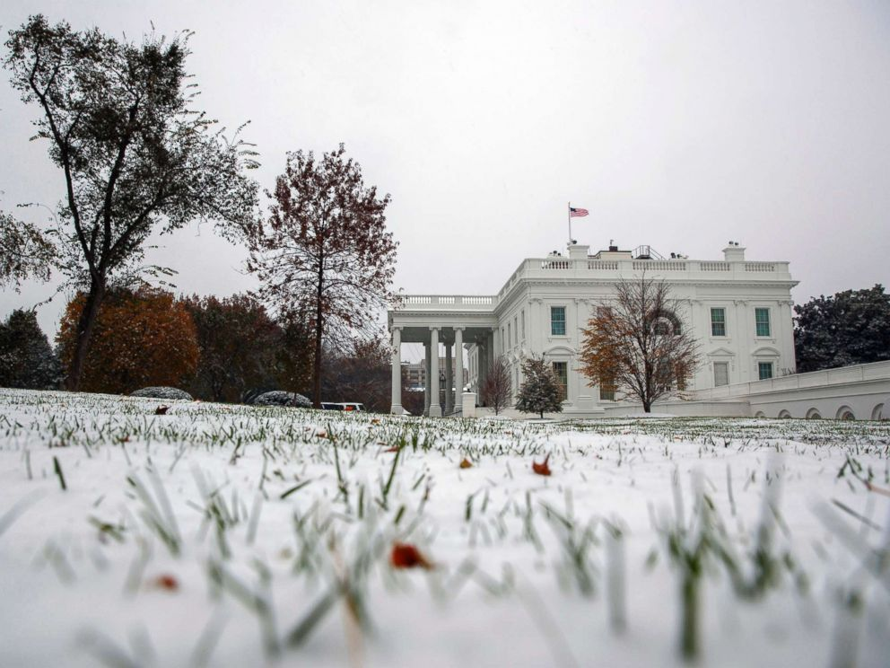 PHOTO: Snow covers the grass outside the White House, Nov. 15, 2018, in Washington.
