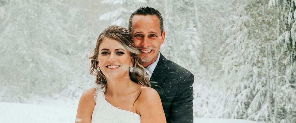 PHOTO: A bride and groom expecting fall foliage as the background of their wedding day were greeted by a snowstorm in Mount Spokane, Wash., Sept. 28, 2019.