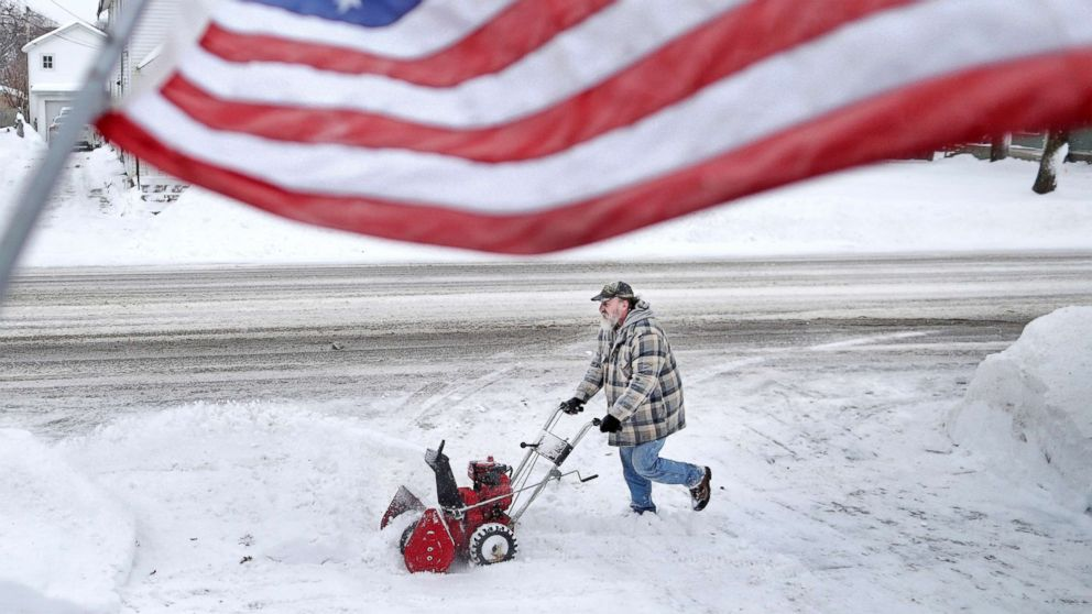 Jan White clears snow from his driveway, Jan. 28, 2019, following a winter snowstorm that made its way through Janesville, Wis.