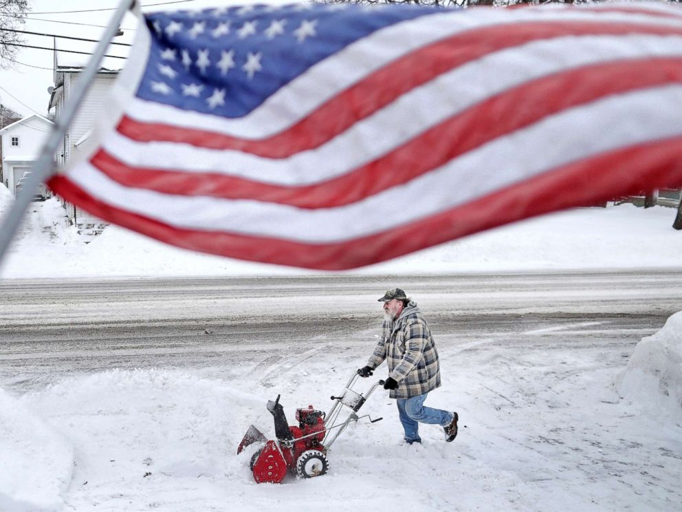 PHOTO: Jan White clears snow from his driveway, Jan. 28, 2019, following a iciness blizzard that made its manner via Janesville, Wis.