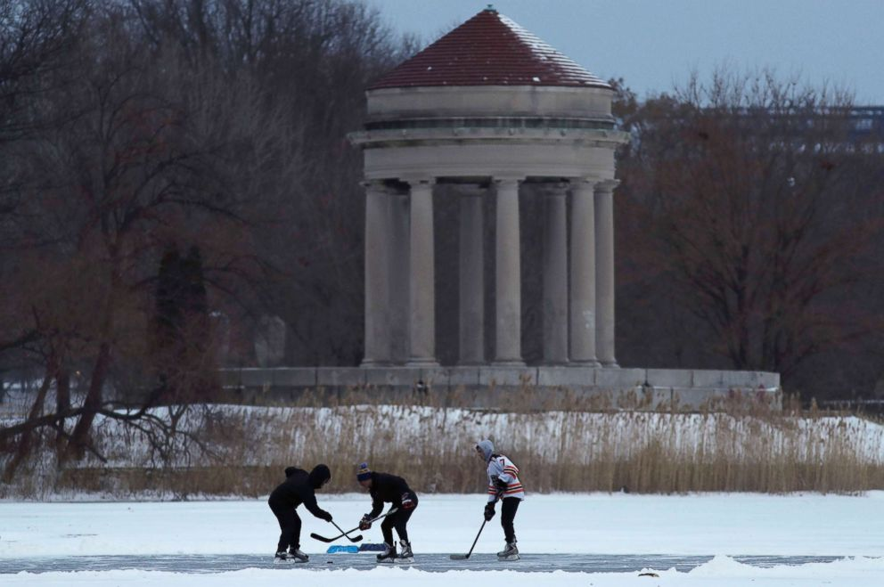 PHOTO: People play ice hockey on a frozen pond at Franklin Delano Roosevelt Park during a winter storm, Jan. 4, 2018, in Philadelphia.