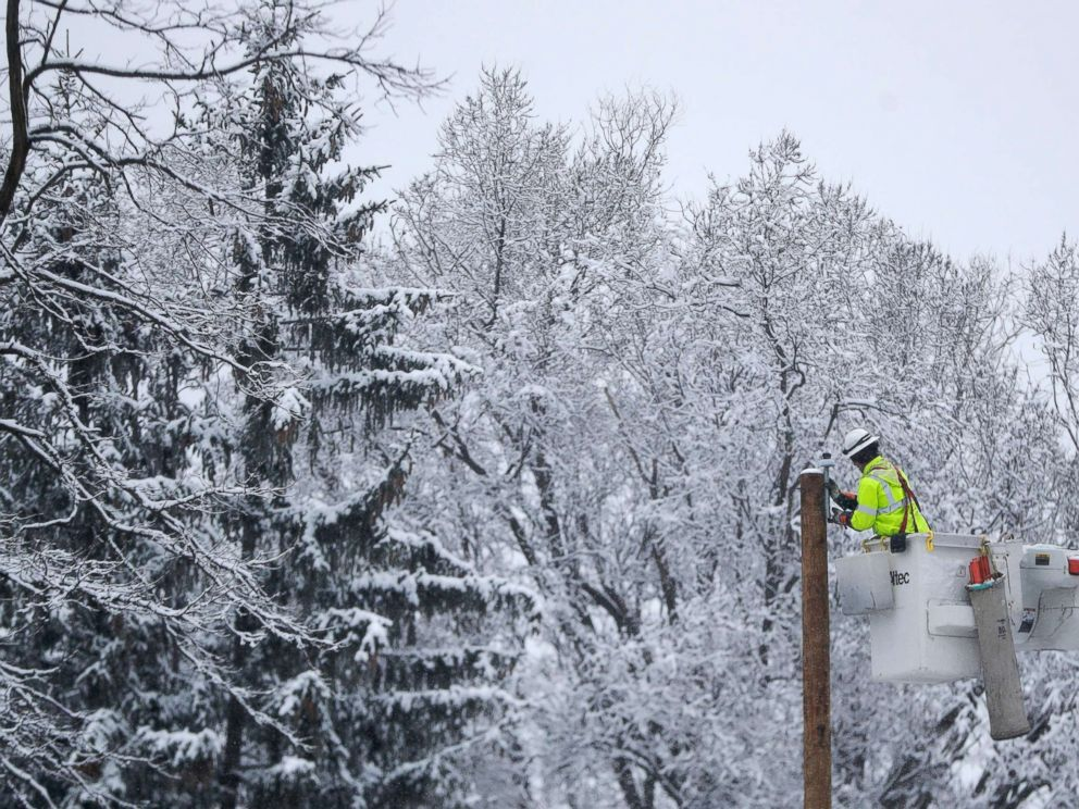 PHOTO: Phil Blair, a utility worker with PotomacEdison out of West Virginia, works on setting up a new power line as a crew works on restoring power along Molly Stark Drive ahead of a winter storm, Wednesday, March 7, 2018, in Morristown, N.J.