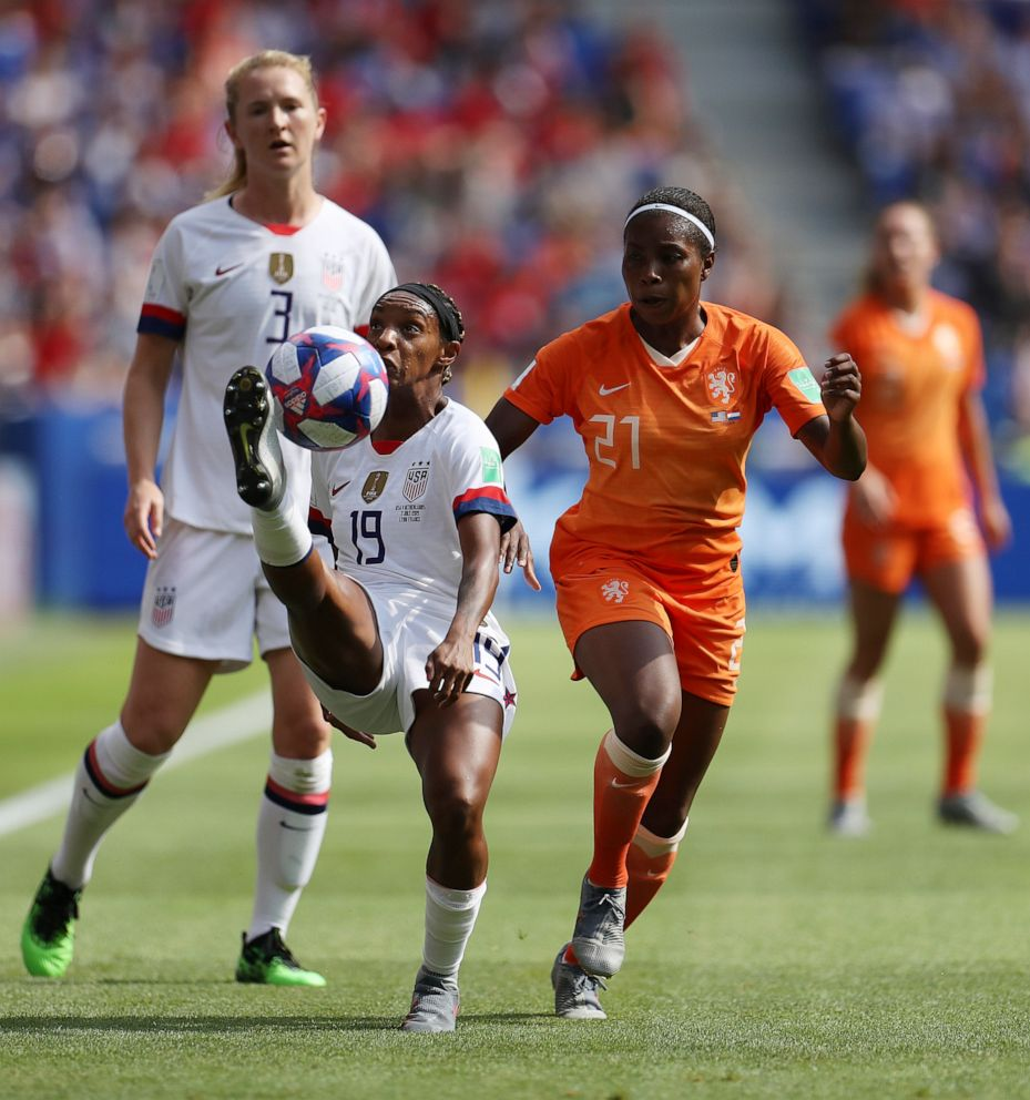PHOTO:Crystal Dunn of the U.S. clears the ball as she is put under pressure by Lineth Beerensteyn of the Netherlands during the 2019 FIFA Womens World Cup France final match in Lyon, France.