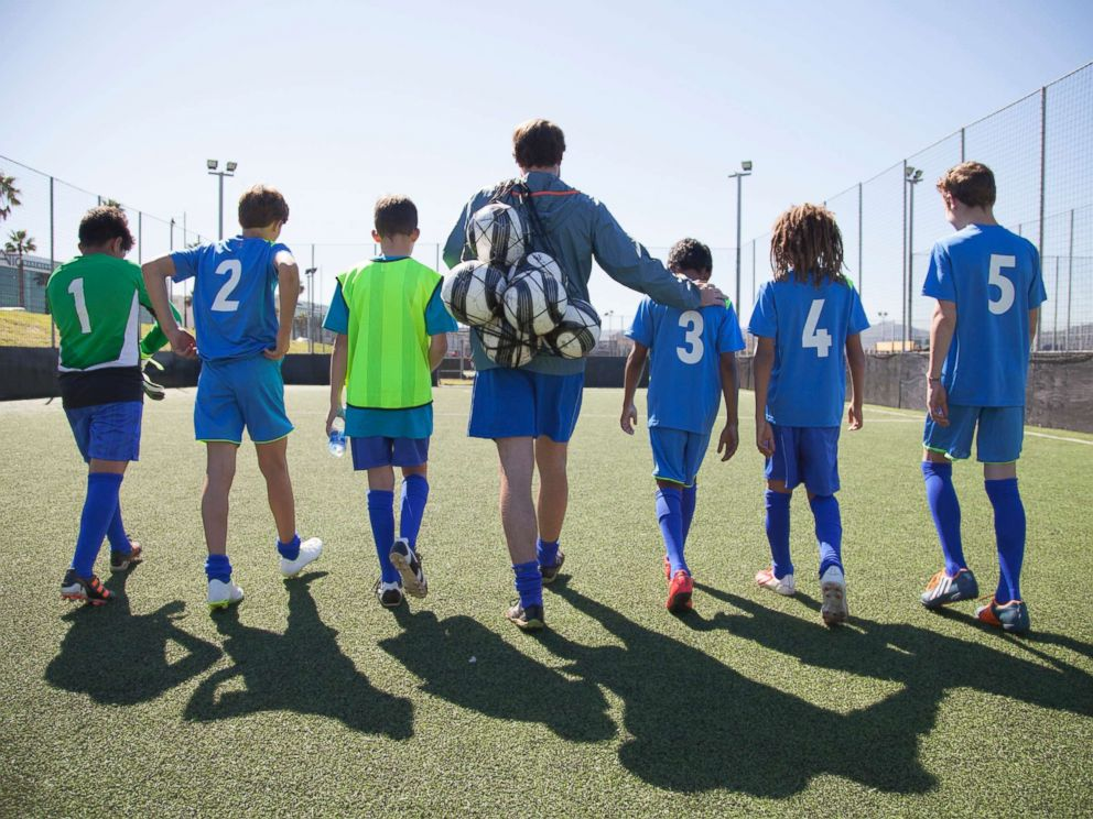 PHOTO: Boys in a soccer team walk out for a game with their coach in this undated stock photo.