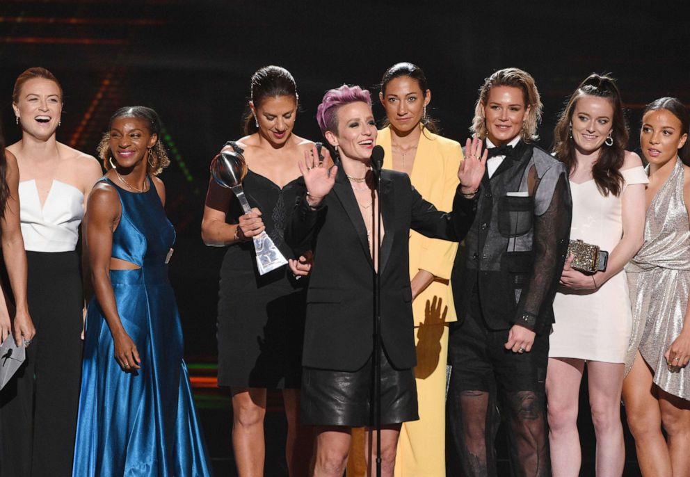 PHOTO: Megan Rapinoe, center, and members of the U.S. womens national soccer team accept the award for best team at the ESPY Awards in Los Angeles, July 10, 2019.