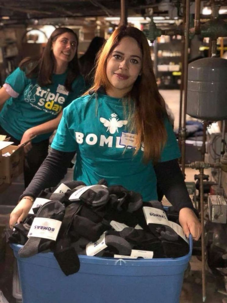 PHOTO: Two college students are photographed organizing Bombas socks to donate.