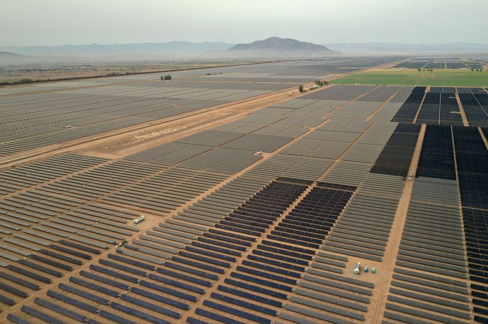 PHOTO: Smoke from wildfires is seen past photovoltaic panels at the Calexico Solar Farm II in this aerial photograph taken over Calexico, Calif., Sept. 11, 2020.