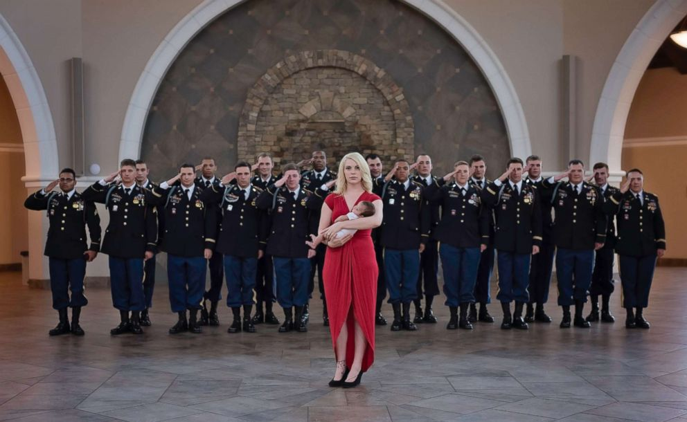 PHOTO: Christian Harris, the daughter of Army Specialist Chris Harris who was killed last year, took part in a special photo shoot with some of Harris former comrades and her mother, Britt Harris.