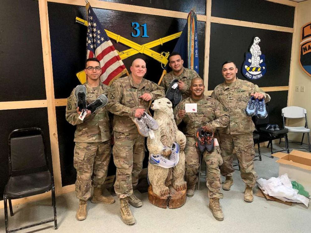PHOTO: Soldiers pose with sneakers sent to them by Sneakers for Soldiers. Deborah Hausladen of Malvern, Pennsylvania, started the nonprofit Sneakers for Soldiers in April 2018 to collect and send shoes to soldiers in need overseas.