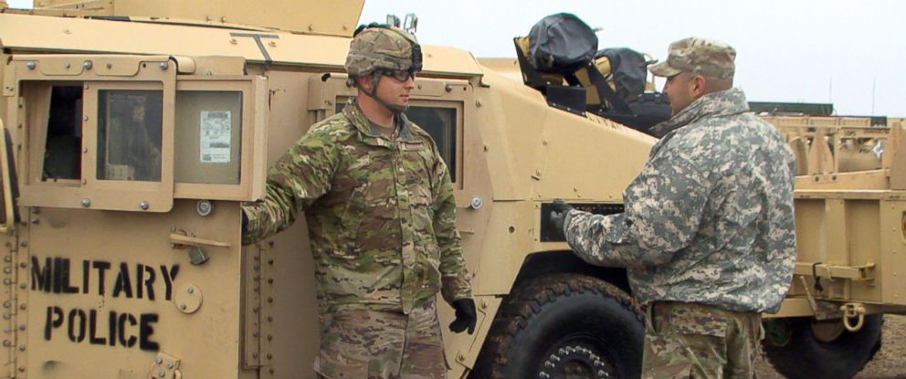 PHOTO: A U.S. Army soldier prepares to drive off base.