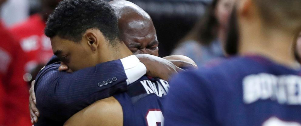 PHOTO: South Carolina State head coach Murray Garvin hugs Ian Kinard (24) as Tyvoris Solomon is attended to after he was injured during an NCAA college basketball game in Raleigh, N.C., Dec. 2, 2017.