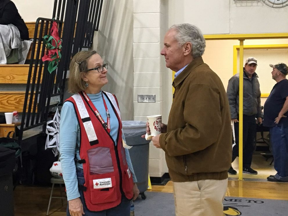 PHOTO: An image released by the American Red Cross shows South Carolina Governor Henry McMaster speaking to a volunteer at a relief site for survivors of a fatal train crash near Cayce, S.C., Feb. 4, 2018.