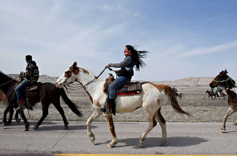 PHOTO: Stephanie Big-Eagle rides along Bombing Range Road on the Pine Ridge Reservation near Scenic, South Dakota, April 20, 2018.