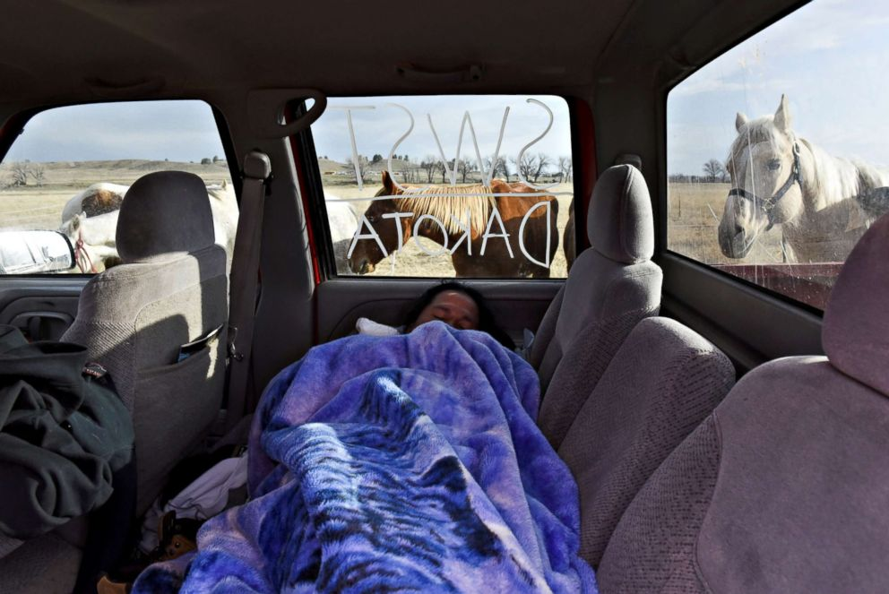 PHOTO: Seth Eastman, from the Sisseton-Wahpeton Sioux tribe, sleeps in the back of a truck in the tribal area of the Fort Laramie National Historic Site in Fort Laramie, Wyoming, April 29, 2018.