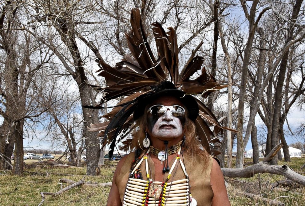 PHOTO: Phil Little Thunder, from the Rosebud Reservation, wears his ceremonial outfit in the tribal area on the grounds of the Fort Laramie National Historic Site in Fort Laramie, Wyoming, April 29, 2018.