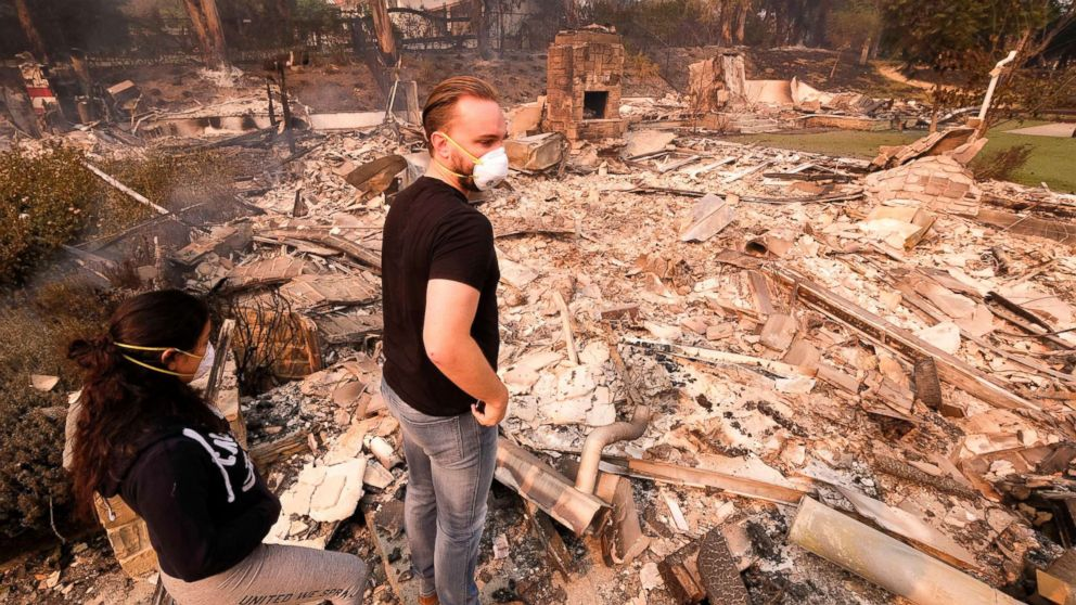 Alexander Tobolsky and his girlfriend Dina Arias return to his home where burned out by the fire in Malibu, Calif., Nov. 10, 2018.