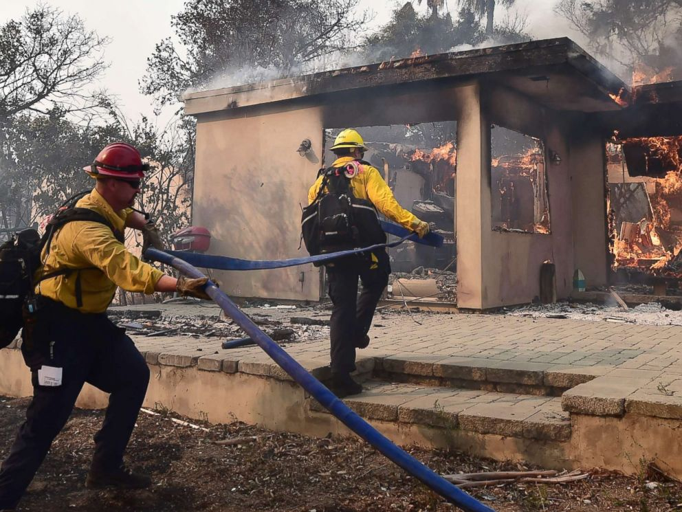 PHOTO: Firefighters knock down flames in the Point Dume neighborhood of Malibu, Calif., on Nov. 10, 2018, after the Woolsey Fire tore through the neighborhood overnight.