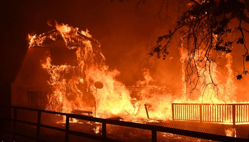 A home burns as overnight firefighters battle the Santa Rosa fire into the morning in Southern California, Nov. 9, 2018.
