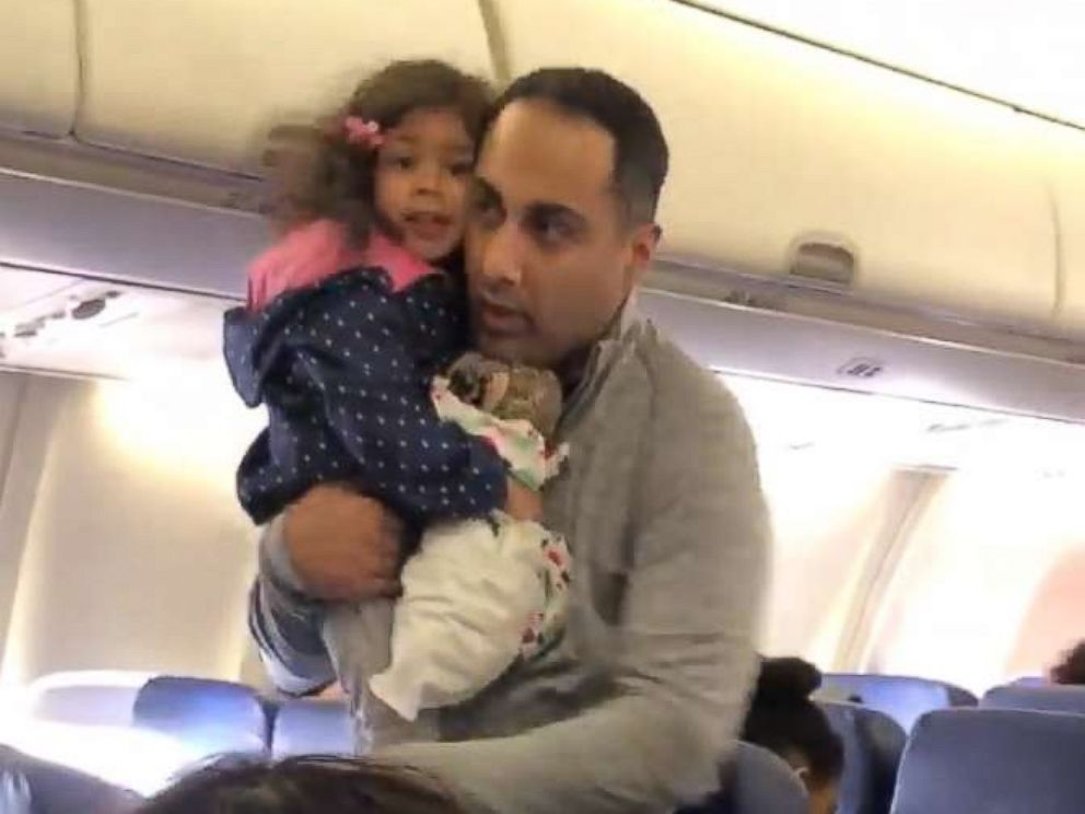 PHOTO: A video grab shows a father and his 2-year-old daughter being removed from a Southwest Airlines flight before takeoff.