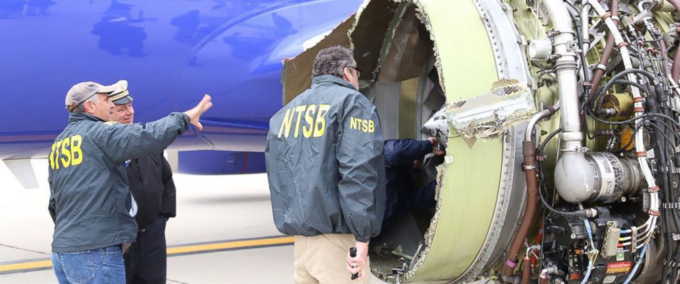 PHOTO: In this file photo obtained April 18, 2018, National Transportation Safety Board investigators on scene examining damage to the engine of Southwest Airlines flight 1380, a Boeing 737-700 jet.