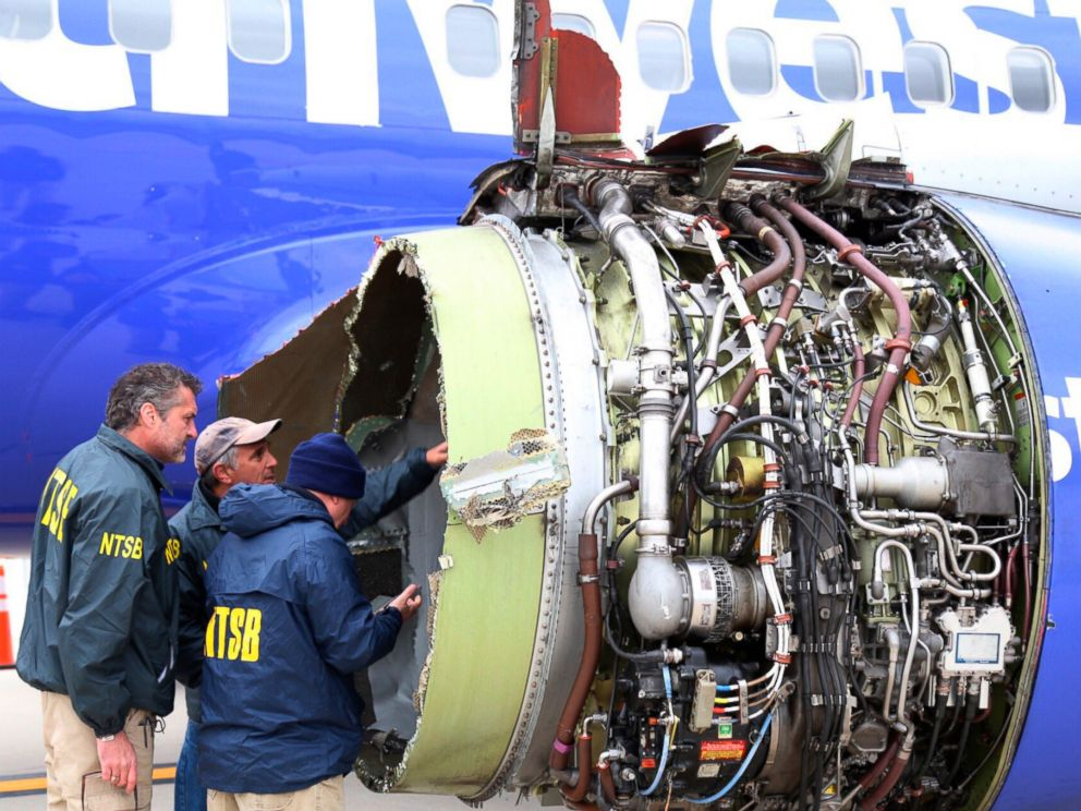 National Transportation Safety Board investigators investigate damage to the Southwest Airlines aircraft engine that landed an emergency landing at Philadelphia International Airport on Tuesday
