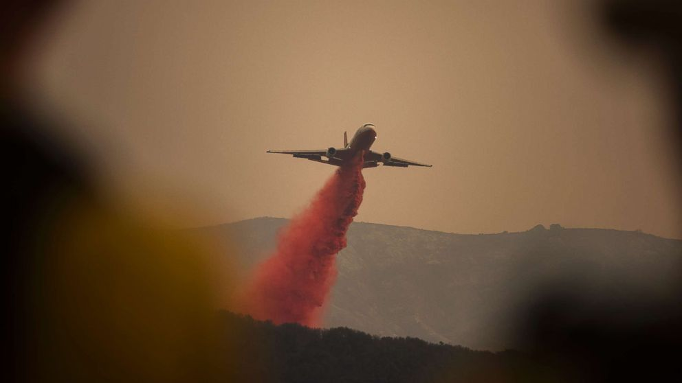 A DC-10 jet, or VLAT (Very Larger Air Tanker) drops fire retardant in Toro Canyon, Calif. on Monday afternoon, Dec. 11, 2017, before anticipated winds caused the fire to burn downhill.