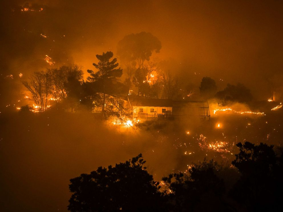 PHOTO: A home surrounded by fire in Toro Canyon, Calif. on Dec. 11, 2017. Firefighters saved the home with minutes to spare but some outbuildings and a vehicle were burned.