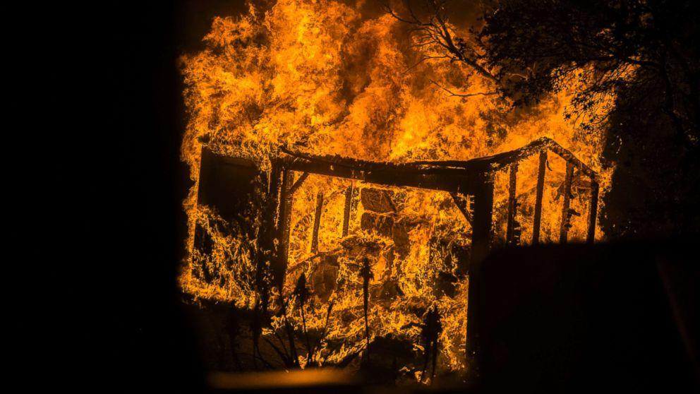 An outbuilding burns in Toro Canyon, Calif. on Dec. 11, 2017.