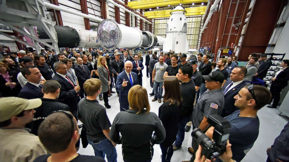 Vice President Mike Pence talks with SpaceX employees during a tour of the SpaceX hangar at Launch Complex 39-A, where the Dragon crew module and Falcon 9 booster rocket are being prepared for a January 2019 launch at Cape Canaveral, Fla., Dec. 18, 2018.