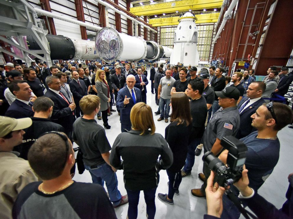 PHOTO: Vice President Mike Pence talks with SpaceX employees during a tour of the SpaceX hangar at Launch Complex 39-A in Cape Canaveral, Fla., Dec. 18, 2018.