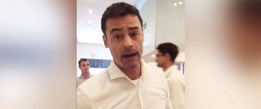 PHOTO: An image made from video shared to social media on May 15, 2018 shows Aaron Schlossberg threatening to call ICE on people who spoke Spanish in a restaurant in New York.