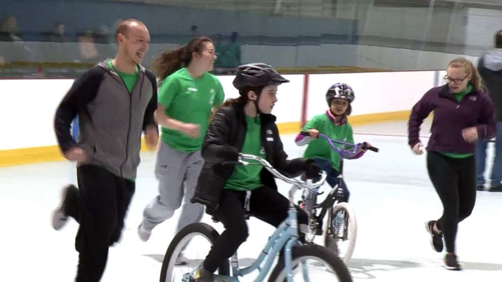 PHOTO: Kids participate in a week-long bike camp run by Emerson Hospital in Groton, Mass., teaching children with special needs to ride bikes, April 2018.