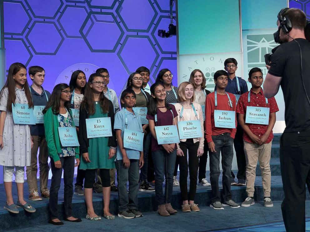 PHOTO: Spellers who have advanced to the evening round pose for a group picture after round eight of the 91st Scripps National Spelling Bee at the Gaylord National Resort and Convention Center May 31, 2018 in National Harbor, Maryland.