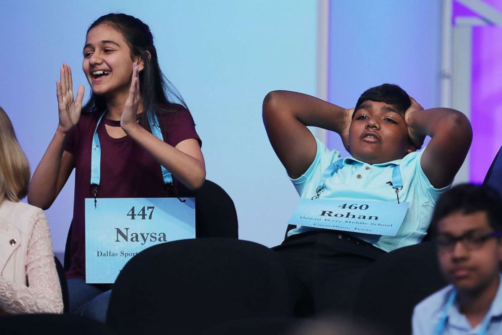 PHOTO: Naysa Modi, left, of Frisco, Texas and Rohan Raja of Irving, Texas, react to the news that they have advanced to the final rounds of the 91st Scripps National Spelling Bee, May 31, 2018 in National Harbor, Maryland.