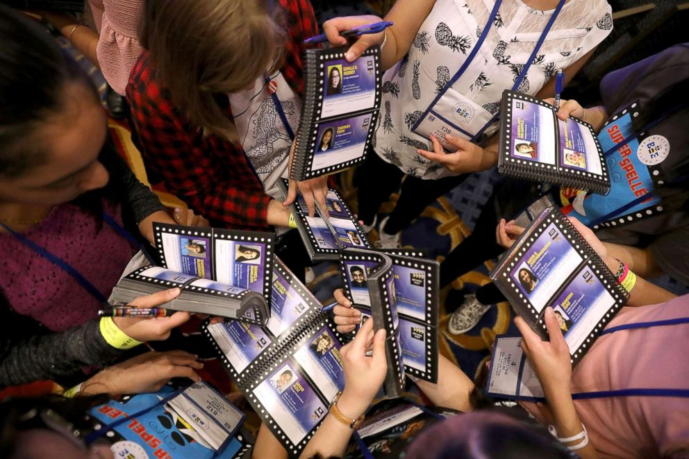 PHOTO: Competitors exchange and sign each others Bee Keeper books during the final day of the 91st Scripps National Spelling Bee at the Gaylord National Resort and Convention Center May 31, 2018 in National Harbor, Maryland.