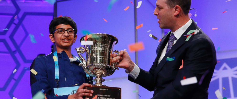 PHOTO: Karthik Nemmani, 14, from McKinney, Texas, left, holds his trophy with President and CEO of the E.W. Scripps Company Adam Symson as confetti falls after winning the Scripps National Spelling Bee in Oxon Hill, Md., May 31, 2018.